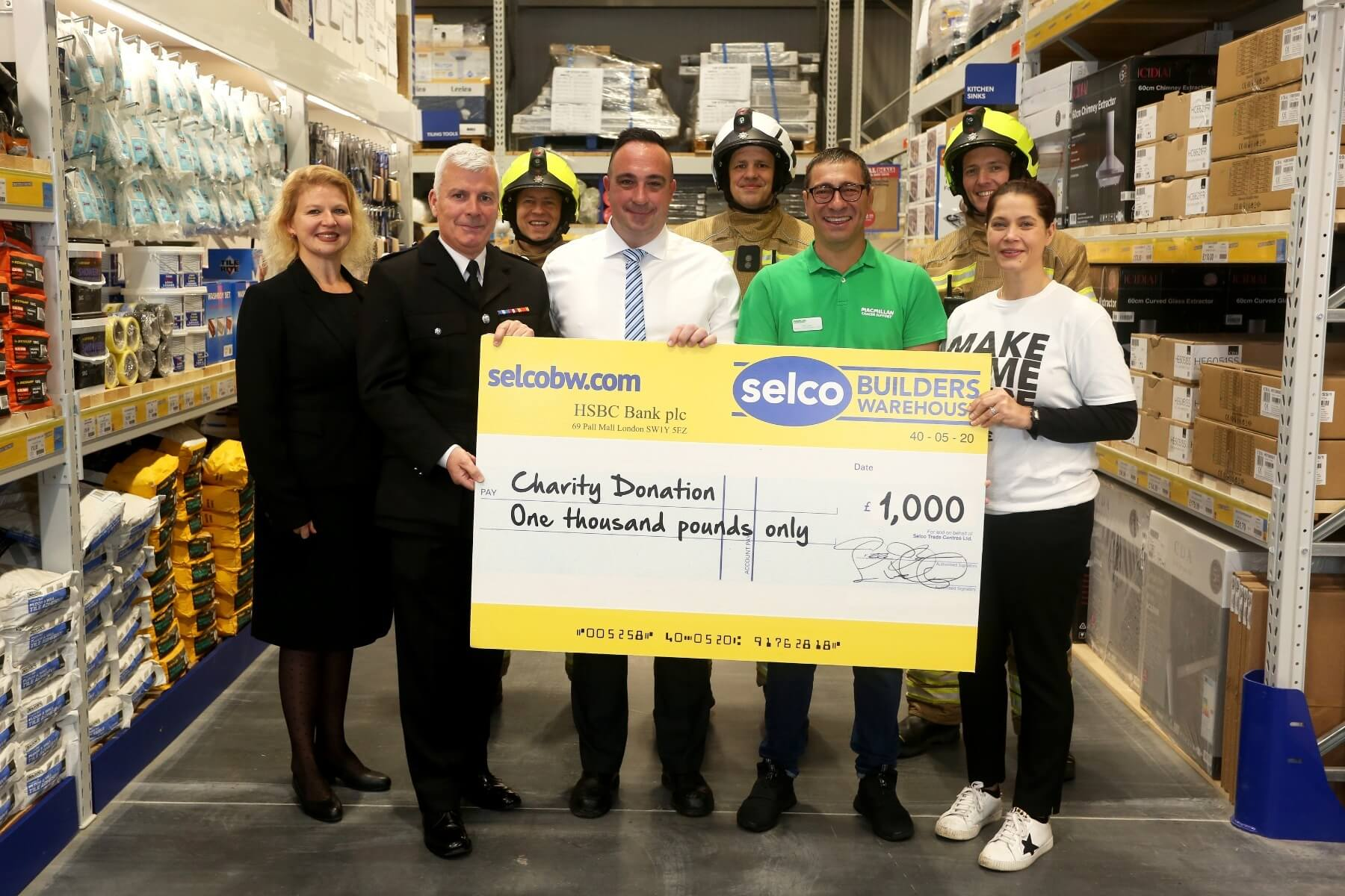 Selco presenting cheque to charity.